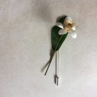 ZAGARA lapel pin parchment